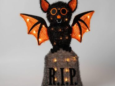 cute tinsel bat on tombstone